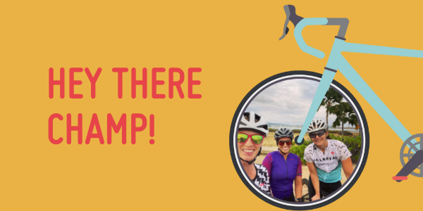 A yellow rectangle with text saying 'hey there champ!'. There is an illustration of a bike coming from the right and inside the wheel is a photo of a group of happy women with their bikes.