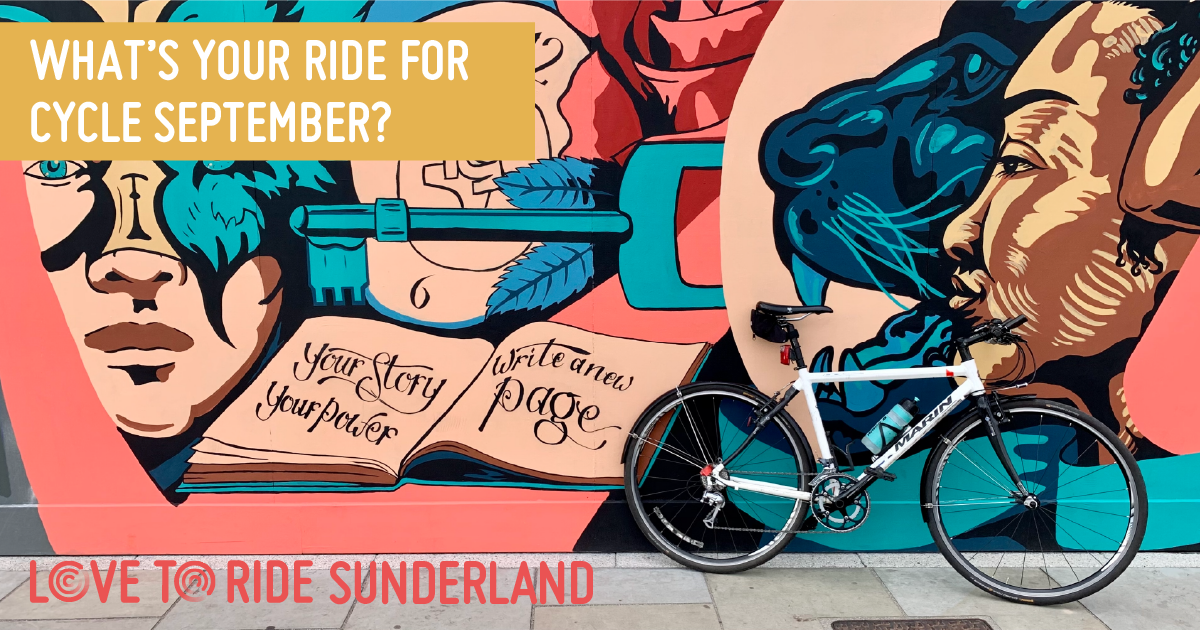 A bike propped up against a wall covered in a large colourful mural which contains images of faces, a key, and an open book containing the words 'your story your power, write a new page'. The text on the asset says 'what's your ride for Cycle September?'.