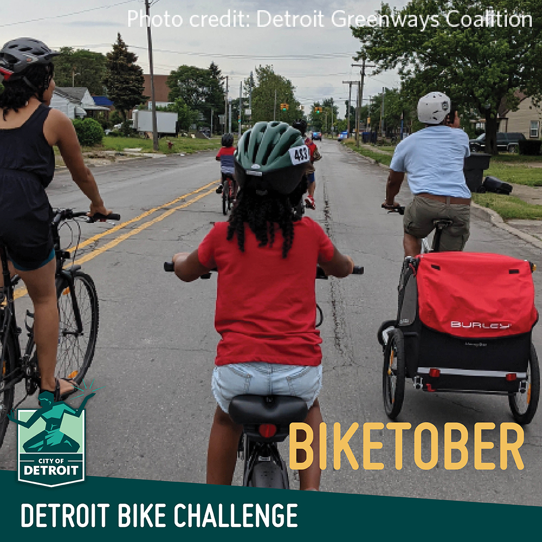 """A family on a bike ride rides away from the camera with the text """"Detroit Bike Challenge - Biketober"""""""
