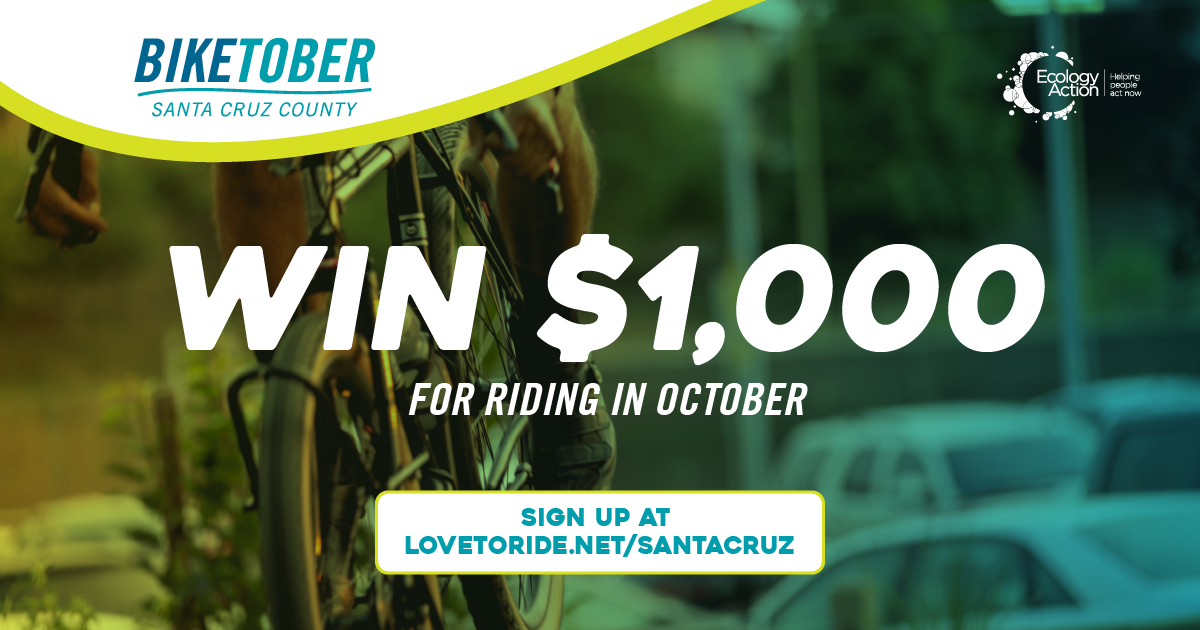 Biketober Santa Cruz County social media post of a zoomed in bike wheel and bike frame. The angle is as if someone is riding the bike. The image has a green blue overlay theme. Text reads 'win $1000 for riding in October'.
