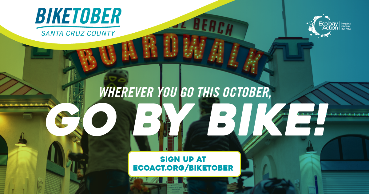 Biketober Santa Cruz County social media post with two people pushing their bikes down a road underneath a light up sign 'Boardwalk'. They have helmets on and the image has a green blue overlay theme. Text reads 'where you go this October, go by bike!'.