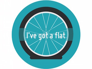 Circle with an illustration of a flat bike tyre