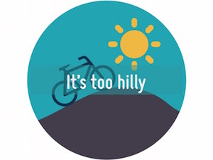 A circle containing an illustration of a bike going up a hill with a sun in the sky