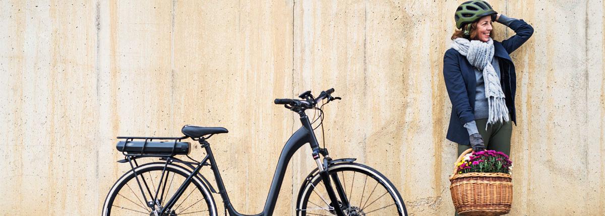 Confident rider standing next to bike